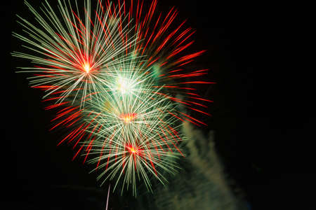 fires artificial: colorful fireworks in dark sky with smoke, copyspace on the right Stock Photo