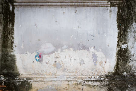 creaky: grunge wall with dirt on the left and right, copyspace in the middle. Stock Photo