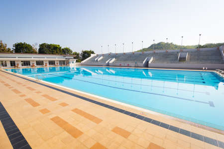 screened: empty swimming pool in sunny day, wide shot, horizontal.