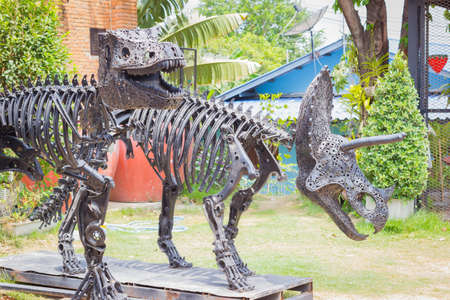 remnant: Tyrannosaurus Dinosaur made of remnant of iron in public park.