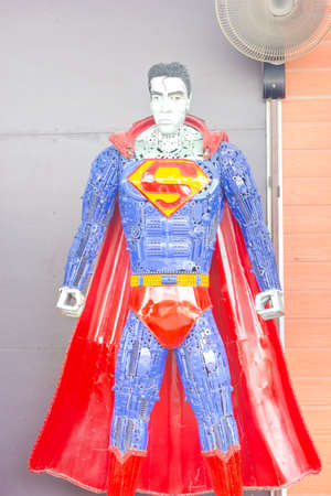 trash the dress: ANG THONG, THAILAND - APRIL 3 :  Superman made of remnant of iron on April 3, 2016 in Ang Thong, Thailand