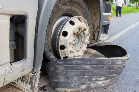 18 wheeler: CHIANG RAI, THAILAND - SEPTEMBER 27 : closeup damaged 18 wheeler semi truck burst tires by highway street with unidentified driver standing beside on September 25, 2015 in Chiang rai, Thailand
