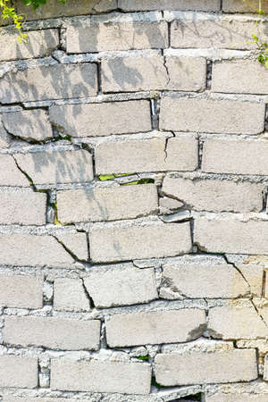 tsunamis: closeup of dangerous wall with cracks. Stock Photo