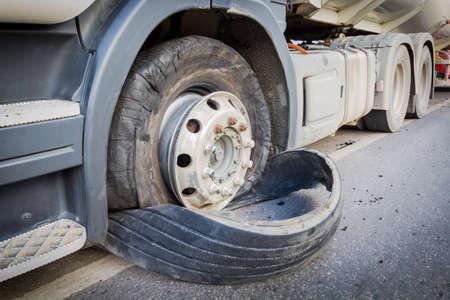 wheeler: closeup damaged 18 wheeler truck burst tires by highway street