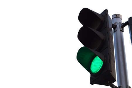 green color on the traffic light isolated on white background.