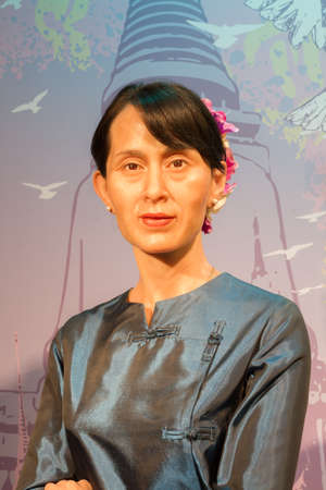 stature: BANGKOK, THAILAND - DECEMBER 19: Wax figure of the famous Aung San Suu Kyi from Madame Tussauds on December 19, 2015 in Bangkok, Thailand