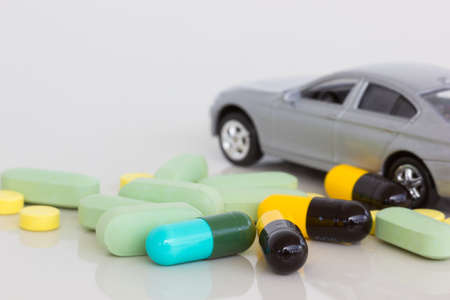 doze: horizontal photo of medicine with blurred gray car on the background Stock Photo