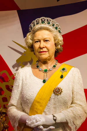 celeb: BANGKOK, THAILAND - DECEMBER 19: Wax figure of the famous Queen Elizabeth from Madame Tussauds on December 19, 2015 in Bangkok, Thailand