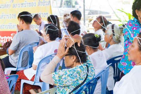rites: CHIANG RAI, THAILAND - SEPTEMBER 1 : unidentified people taking holy thread on their head in Thai traditional rites on September 1, 2016 in Chiang rai, Thailand. Editorial
