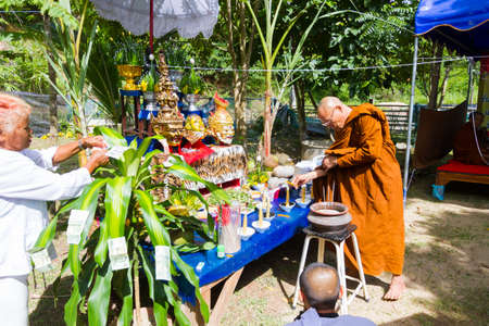 thai monk: CHIANG RAI, THAILAND - SEPTEMBER 1 : unidentified thai monk ritualising in front of altar tables in ancient Thai traditional style on September 1, 2016 in Chiang rai, Thailand. Editorial