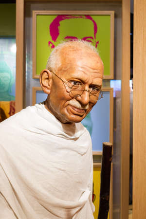 unveiling: BANGKOK, THAILAND - DECEMBER 19: Wax figure of the famous Mahatma Ghandi from Madame Tussauds on December 19, 2015 in Bangkok, Thailand.