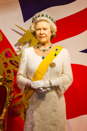 BANGKOK, THAILAND - DECEMBER 19: Wax figure of the famous Queen Elizabeth from Madame Tussauds on December 19, 2015 in Bangkok, Thailand