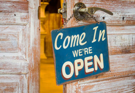 come in: Come In Were Open on the wooden door open Stock Photo