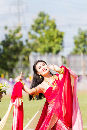 CHIANG RAI, THAILAND - SEPTEMBER 19 : unidentified unidentified beautiful young Thai dancer participating parade for sporting day on September 19, 2016 in Chiang rai, Thailand
