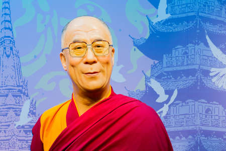 dalai: BANGKOK, THAILAND - DECEMBER 19: Wax figure of the famous Dalai Lama from Madame Tussauds on December 19, 2015 in Bangkok, Thailand. Editorial
