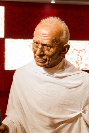 mahatma: BANGKOK, THAILAND - DECEMBER 19: Wax figure of the famous Mahatma Ghandi from Madame Tussauds on December 19, 2015 in Bangkok, Thailand.
