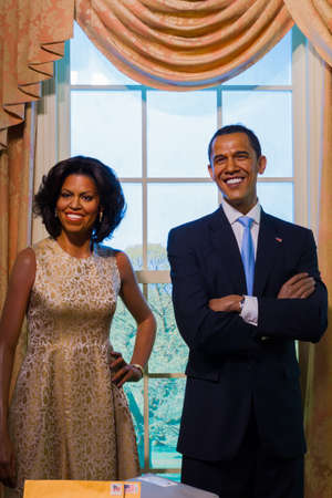 illustrative material: BANGKOK, THAILAND - DECEMBER 19: A waxwork of Barack and Michelle Obama on display at Madame Tussauds on December 19, 2015 in Bangkok, Thailand Editorial