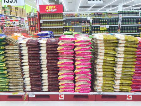 CHIANG RAI, THAILAND - OCTOBER 28 : various brand of pile of packed rice for sale on supermarket stand or shelf in Big C Supercenter on October 28, 2016 in Chiang rai, Thailand.