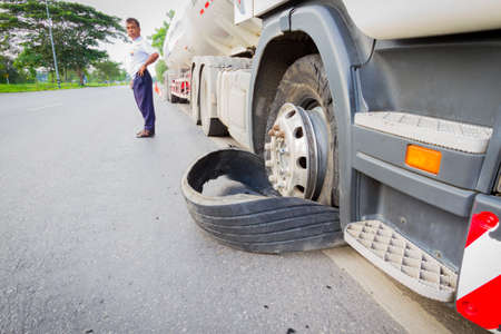 18 wheeler: CHIANG RAI, THAILAND - SEPTEMBER 27 : closeup damaged 18 wheeler semi truck burst tires by highway street with unidentified driver standing beside on September 25, 2015 in Chiang rai, Thailand..