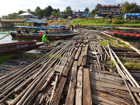 KANCHANABURI, THAILAND - NOVEMBER 25: wooden raft near the old wooden Mon Bridge in Sangkhla Buri on November 25, 2016 in Kanchanaburi, Thailand Editorial