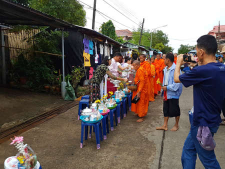 most creative: KANCHANABURI, THAILAND - NOVEMBER 25: unidentified people, give food offerings to monks in the morning at Sangkhlaburi on November 25, 2016 in Kanchanaburi, Thailand