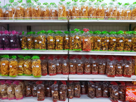 CHIANG RAI, THAILAND - NOVEMBER 25: snack made of agricultural products in packaging for sale on supermarket stand or shelf in Seven Eleven on November 25, 2016 in Chiang rai, Thailand.
