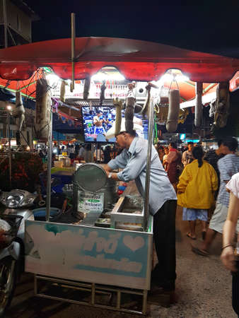 most creative: CHAIYAPHUM, THAILAND - NOVEMBER 27 : unidentified man selling ice cream at walking street in night market on November 27, 2016 in Chaiyaphum, Thailand Editorial