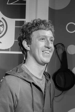 mark zuckerberg: BANGKOK, THAILAND - DECEMBER 19: Wax figure of the famous Mark Zuckerberg from Madame Tussauds on December 19, 2015 in Bangkok, Thailand. Black and white Photo.