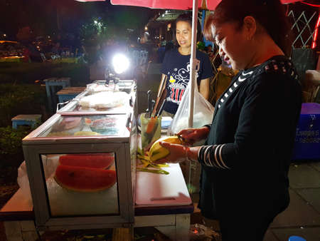 most creative: AYUTTHAYA, THAILAND - NOVEMBER 28: unidentified people selling mango in walking street in the night on November 28, 2016 in Ayutthaya, Thailand.