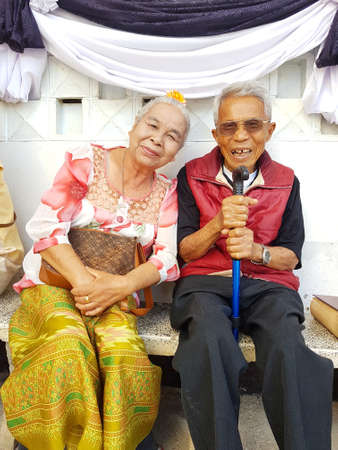 CHIANG RAI, THAILAND - FEBRUARY 5 : unidentified smiling old asian couple sit together on February 5, 2017 in Chiang rai, Thailand. Editorial