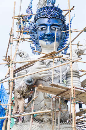 CHIANG RAI, THAILAND - FEBRUARY 12 : Unidentified man working creating big clay statues in Wat Rong Sua Ten temple on February 12, 2017 in Chiang rai, Thailand.