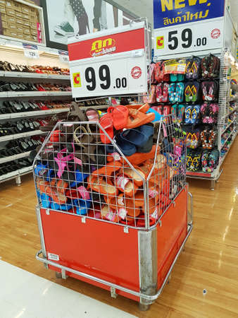 CHIANG RAI, THAILAND - FEBRUARY 15 : various brand of discount toe post sandals for sale on supermarket stand or shelf  on February 15, 2017 in Chiang rai, Thailand.