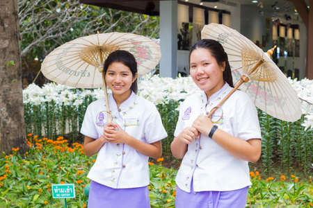 mulberry paper: CHIANGRAI, THAILAND - DECEMBER 7: unidentified asian women with Mulberry paper umbrella in flower festival on December 7, 2016 in Chiangrai, Thailand. Editorial