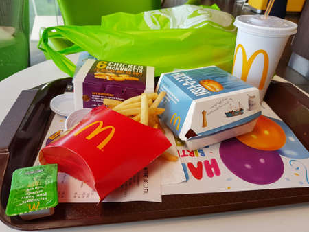 CHIANG RAI, THAILAND - MARCH 1 : fish burgers, french fries, soft drink and nuggets on table at McDonalds restaurant on March 1, 2017 in Chiang rai, Thailand
