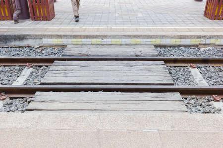 wood railways: closeup wood bridge crossing railroad tracks