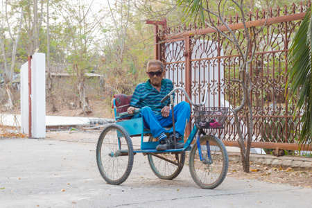 CHIANG RAI, THAILAND - FEBRUARY 19 : Unidentified asian man suffering from leprosy on tricycle on February 19, 2016 in Chiang rai, Thailand. Editorial