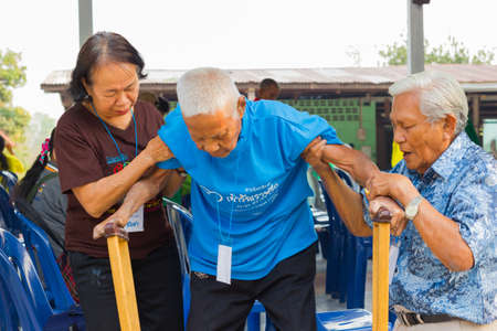 CHIANG RAI, THAILAND - FEBRUARY 20 : unidentified couple helping leprosy asian old man on February 20, 2016 in Chiang rai, Thailand.