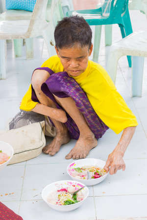 CHIANG RAI, THAILAND - FEBRUARY 19 : Unidentified old asian woman suffering from leprosy eating food on February 19, 2016 in Chiang rai, Thailand. Editorial