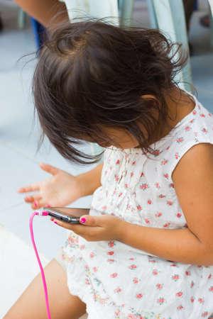 girl playing handphone.