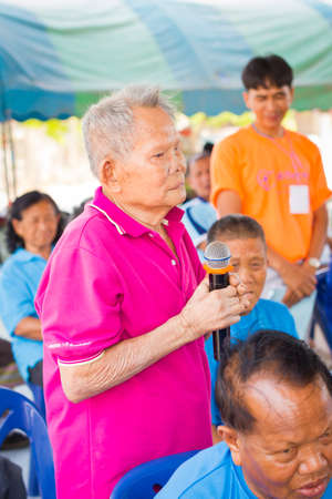 CHIANG RAI, THAILAND - FEBRUARY 20 : unidentified man suffering from leprosy with pink shirt speak out at Christian camp on February 20, 2016 in Chiang rai, Thailand. Editorial