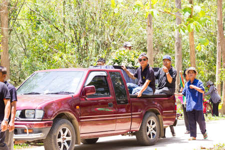 undertaker: CHIANG RAI, THAILAND - APRIL 19 : pickup carrying coffin to the graveyard on April 19, 2017 in Chiang rai, Thailand.