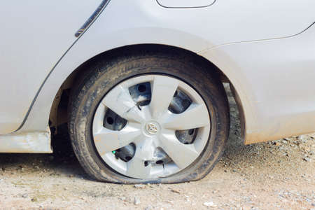 CHIANG RAI, THAILAND - NOVEMBER 13 : flat tire of TOYOTA car on November 13, 2014 in Chiang rai, Thailand.