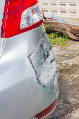 total close-up bronze car in an accident at the back. Safety concept Stock Photo