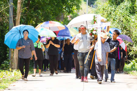undertaker: CHIANG RAI, THAILAND - APRIL 19 : unidentified asian Protestant Christian people walking to the graveyard on April 19, 2017 in Chiang rai, Thailand.
