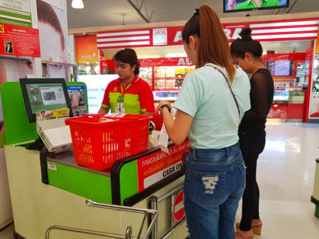 warehouse: CHIANG RAI, THAILAND - MAY 16 : unidentified female customers standing in front of cashier section at supermarket on May 16, 2017 in Chiang rai, Thailand.