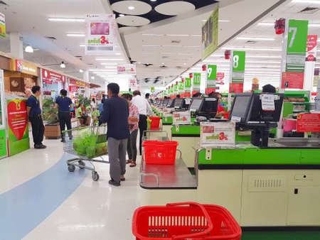 selected: CHIANG RAI, THAILAND - MAY 16 : unidentified customers walking out of the cashier section at supermarket on May 16, 2017 in Chiang rai, Thailand.