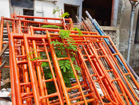 orange scaffolding in construction site for working Stock Photo