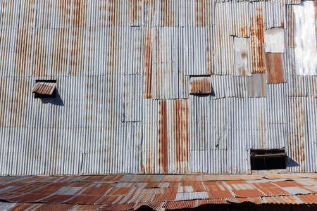 rusty galvanized iron wall of retro house