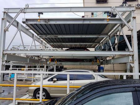 BANGKOK, THAILAND - JULY 17 : Hydraulic car parking or Parking lift with cars stacked of Mongkutwattana general hospital on July 17, 2017 in Bangkok, Thailand