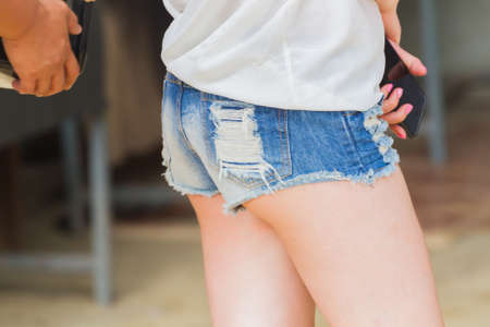 Close-up back of asian woman wearing denim shorts blue jeans Stock fotó